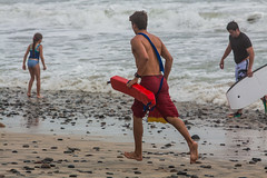 Oceanside Lifeguards (EthnoScape) Tags: oceanside california cityofoceansidelifeguard lifeguards oceansidelifeguard oceansidelifeguards training trainer assistance drown drowning surf surfer surfboard lifesaver lifesavers rescue rescuer rescuetube rookie swim swimming swimmer swimmers athlete athletic health fitness youth boardshorts bikini wetsuit neoprene lycra rubber fiberglass polyurethane danger riptide ripcurrent red yellow baywatch fins swimfins tower lifeguardtower beach shore ocean water safety tourist touristseason jetski summer ethnoscape ethnoscapeimagery outdoor oceansidepier
