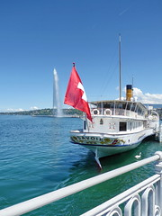 Going on a little journey (zinnia2012) Tags: lakelman flag fountain jetdeau swan blue red white water serene bateau railings genve switzerland drapeau