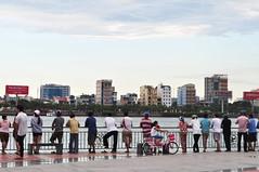 Silent vigil (Roving I) Tags: news events vietnam railing vigil danang hanriver tragedies tourboats incidents