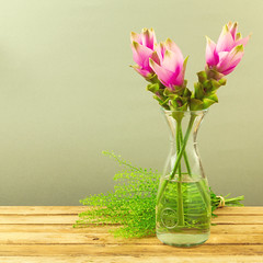Beautiful pink flower bouquet on wooden table (noor.khan.alam) Tags: wood pink wallpaper stilllife holiday flower reflection green texture water glass beautiful vintage poster table design israel wooden day natural bright artistic background branches rustic vivid retro mothers celebration exotic invitation card cover gift page tropical present vase backdrop romantic bouquet unusual copyspace brochure greeting tabletop