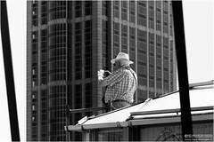 Grandpa goes high (Passie13(Ines van Megen-Thijssen)) Tags: street people blackandwhite bw netherlands hat canon high rotterdam photographer zwartwit grandpa sw opa trap straat zw hoed handelsgebouw inesvanmegen inesvanmegenthijssen traprotterdam