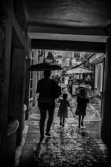 umbrella girls (Daz Smith) Tags: city uk girls portrait people urban blackandwhite bw streets blancoynegro wet monochrome umbrella canon blackwhite bath candid mother citylife thecity streetphotography daughters rainy raining canon6d dazsmith