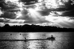 Omsk. Irtish. (Indigo_Flow) Tags: russia river sky blackandwhite sun clouds lights dark water boat reflection rays siberia omsk irtish