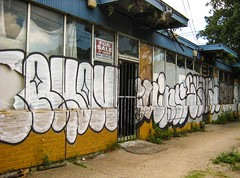 For sale storefront with graffiti Louisiana Ave. Milan New Orleans (Chailley) Tags: urban art graffiti realestate storefront