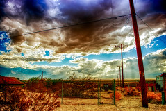 The Dance (hbmike2000) Tags: california sky usa mountains rain clouds fence landscape sand nikon rocks desert coachellavalley repetition d200 telephonepoles liquid hdr crepuscularrays deserthotsprings crepuscular riversidecounty flickrfriday ourdailychallenge fencedfriday hbmike2000