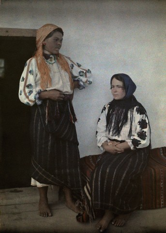 1930 - An informal portrait of two women in traditional clothing