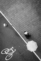hide me or chase me (Kim S. Landgraf) Tags: street city people urban blackandwhite bw streets public monochrome rain umbrella blackwhite kim streetphotography streetscene olympus streetphoto freiburg birdseyeview 45mm omd streetphotographer inpublic publiclife streetcandid streetpicture kimlandgraf em5 streetpic unasked kimslandgraf