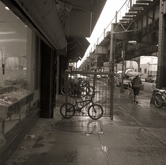when the rain comes,,, (Robert S. Photography) Tags: street nyc morning rain fog sepia brooklyn umbrella subway bicycles canonpowershot