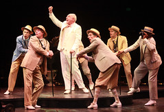 "(Center) Lenny Wolpe (Osgood Fielding, Jr.) and ensemble in the musical Sugar, based on the film ""Some Like It Hot,"" produced by Music Circus at the Wells Fargo Pavilion July 23 -28, 2013. Photo by Charr Crail."