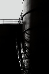 oil tanks, uk (Neal J.Wilson) Tags: stairs shadows oil refinery oiltanks vision:text=0582 vision:outdoor=0598 vision:sky=0653 vision:dark=0725