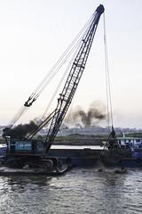 Crane dredging the Mekong (Keith Kelly) Tags: city cruise sunset tractor water river fun boat sand asia cambodia seasia southeastasia mud crane capital phnompenh kh aroundtown barge mekong exhaust dredge dredging tonlesap kampuchea dredgingderrick