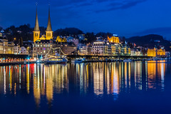 Lucerne Night City Life (notjustnut) Tags: lighting city travel lake reflection building church water night court river landscape switzerland twilight cityscape cloudy swiss citylife landmark traveller land lucerne lakelucerne luzer vision:outdoor=0976 vision:sky=0844 vision:dark=076 courtchurchofstleodegar
