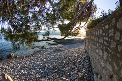 Hidden from the sun (Tomislav C.) Tags: sea panorama sun mountains beach nature beauty pine clouds walking landscape coast waves natural walk branches croatia sunny surface waterslide twigs rijeka theadriatic