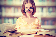 Funny Girl Student With Glasses Reading Books (Spanish Virtually) Tags: school portrait people woman white cute college girl beautiful beauty face female fun happy person grey reading one glasses book crazy student education funny university pretty looking adult head expression background library humor young literature read teacher study teen attractive learning knowledge teenager cheerful schoolgirl exam studying learn caucasian