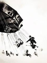 Feeling Free (Demmer S) Tags: park street carnival people blackandwhite bw chicago painterly monochrome sepia kids fun outdoors person flying blackwhite chains illinois kid downtown ride fairground loop streetphotography tint fair swing lakemichigan il chain entertainment round spinning amusementpark navypier swinging toned tones tone thrills tinted bnw touristattraction thrill intheair peoplewatching chicagoland whirling carnivalride spins toning windycity chicagoist blackwhitephoto waveswinger swingride blackwhitephotos spinningswing chicagoistphotos