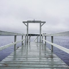 Seduced by the Dock Side (mediafury) Tags: dock maine boothbayharbor linekinbayresort sea atlantic ocean water waves grey gray cloudy fog foggy arch perspective balance symmetry vanishingpoint converginglines weather outside