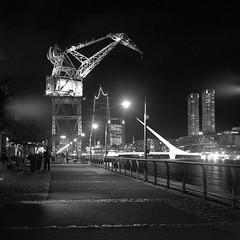 Nights at Buenos Aires (Rafakoy) Tags: city people blackandwhite 6x6 tlr water argentina skyline night port walking square lights buenosaires cityscape kodak crane tmax walk 400 format puertomadero flares tmy yashicamat 80mm kodaktmax400tmy kodakhc110 yashinon80mmf35