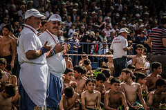 Prayer time (Melissa Maples) Tags: men boys sport turkey athletics nikon asia stadium muslim islam prayer trkiye crowd antalya athletes bleachers nikkor spectators wrestlers turks vr afs stands  18200mm  yalgre f3556g oilwrestling  18200mmf3556g d5100 greasewrestling konuksever muratpaayalpehlivangreleri