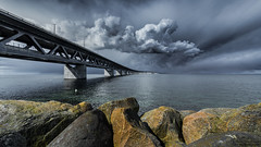 The bridge (johanbe) Tags: road bridge light sea sky storm water copenhagen dark denmark rocks cloudy sweden stones bro malm sundet bron hav resund broen resundsbron stenar kpenhamn