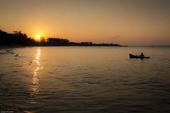 I'm trying to reach the sun... but it's faster than me... (Srgio Miranda) Tags: africa street travel urban beach photography boat photo fujifilm mozambique moz moambique pemba travelphotography x100 fujix sergiomiranda x100t fujix100t