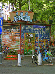 Johnny Jordaanplein (Art By Pem Photography: Tao Of The Wandering Eye) Tags: street city travel blue trees urban stilllife signs color colour green netherlands colors amsterdam bike bicycle sign yellow lumix words europa europe pattern colours pavement letters nederland citylife eu panasonic lettering fineartphotography urbanstilllife dmcfz28