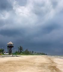 Here comes the Storm! - Esplanade Beach, Miri, Malaysia. (S.T.Chang) Tags: cloud storm beach wet rain weather dark sand miri lifeguard sarawak malaysia thunderstorm watchtower extremeweather darkcloud luakbay esplanadebeach