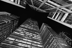 Untitled (domenicocarusophoto) Tags: above nyc travel windows sky urban blackandwhite usa inspiration newyork building travelling up lines architecture modern facade contrast america lights cityscape view nightscape skyscrapers manhattan perspective wideangle diagonal pointofview convergence bnw
