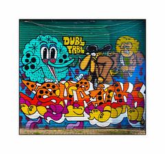 Graffiti (Pins, Dscreet), East London, England. (Joseph O'Malley64) Tags: uk greatbritain england streetart london graffiti mural paint britain pins spray cobblestones wires shutter british cans aerosol cobbles eastend eastlondon dscreet rollershutter muralists burningcandycrew dbltrbl cobbledroadsurface