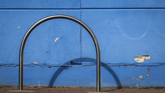 Double Loop (Theen ...) Tags: adelaide bicycle blue concrete dented double loop lumix painted rack shadow stainlesssteel theen wall