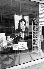 Work In Progress (Man with Red Eyes) Tags: portrait window monochrome analog blackwhite lancashire lancaster shopwindow leicam6 adox silverhalide v850 td201 silvermax 40mmf14voigtlandersc