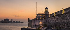 Sunset Over Havana (Geoff Livingston) Tags: sunset sea lighthouse castle architecture sunrise fort havana cuba caribbean