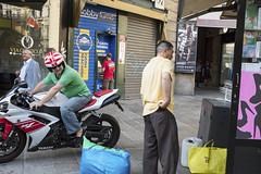 (Giovanni Stimolo) Tags: street city people woman men colors shoes fuji flag helmet shapes streetphotography motorcycle advertisingposter streetreportage x100s fujifilmfinepixx100s urbanreportage