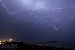 Over the Pier (lightonthewater) Tags: florida floridathunderstorm thunderstorm storm lightning pensacolaflorida pier ocean gulfofmexico beach