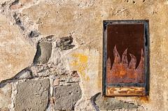 Rusty Flames  (Explored May 11, 2013 #370) (Jordan Morganne) Tags: light italy detail muro colors wall composition fire italia flames explore flame colori livorno luce fuoco fiamma composizione dettaglio fiamme leghorn explored nikond90 antoniogiordano