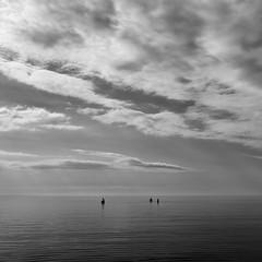 dissolution (zip po) Tags: sea summer people white beach clouds mono evening estonia shadows midsummer silhouettes figures blackand