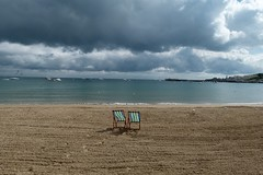 Summers gone (fotobuni) Tags: sea beach seaside sand dorset swanage deckchairs