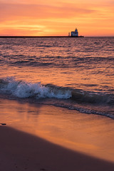 Morning Break (PopsDigital) Tags: morning light red orange sun lighthouse lake color colour reflection beach water silhouette vertical wisconsin clouds sunrise landscape pier early sand waves earlymorning lakemichigan splash wi doorcounty kewaunee kewauneecounty billpevlor popsdigital sonyslta77v