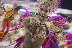 carnival girl in feathers (TerryGeorge.) Tags: black tongue eyes tits braces teeth colourful bellybar nipplrs