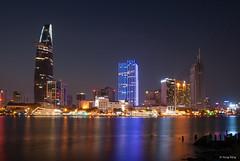 City Nightscape (Dang V. Hung) Tags: city longexposure reflection night river downtown cityscape nightscape vivid vietnam glowing riverbank saigon skyscrapper
