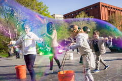 Running through bubbles at Washington Square (laskaproject) Tags: park street city nyc travel portrait people urban sun sunlight ny newyork face architecture backlight outdoors spring rainbow colorful washingtonsquarepark streetphotography bubbles soapbubbles