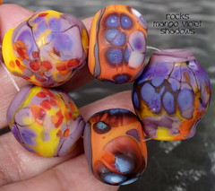 Rocks Mango Violet Shadows (Laura Blanck Openstudio) Tags: show red orange usa white abstract art glass yellow coral festival set one beads big rocks colorful published artist glow purple handmade stones eggplant fine arts violet lavender plum funky jewelry pebbles kind made odd lilac earthy burnt mango donut round winner tropical huge opaque organic kiln nuggets murano umber grape maize lampwork multicolor raku artisan matte whimsical loose frosted openstudio asymmetric ocher speckles annealed opestudiobeads