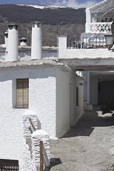 Entre el cielo y el suelo. (elojeador) Tags: ventana reja persiana balcn chimenea piedra capileira lasalpujarras baranda elojeador pedrogullo contendenciaaquedarmecalvo