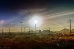 Patagonia (Mauro Esains) Tags: postes atardecer paisaje pasto construccin cerros antiguo reflejos lineas nuves transformador arbusto alumbrado alambres matas coirones