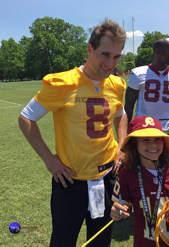 Redskins QB Kirk Cousins signs autographs on opening day of OTAs and takes photos with fans.