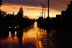Sunset after storm (Andy Ziegler) Tags: road storm wet rain wisconsin spring streetlights headlights powerlines telephonelines telephonepoles canon50mm canon6d