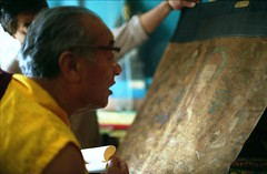 His Holiness Dagchen Sakya Rinpoche examining a very old Thangka of Sakya Pandita, volunteer holding it up, at the Tibetan Works and Archives Library in Dharamsala, India 1993 (Wonderlane) Tags: old very library archives works his tibetan thangka rinpoche dharamsala holiness examining sakya india1993 pandita dagchen daramsala212b hisholinessdagchensakyarinpocheexaminingaveryoldthangkaofsakyapandita volunteerholdingitup atthetibetanworksandarchiveslibraryindharamsala