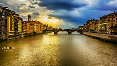 When the light arrives. (Jean McLane) Tags: trip travel water clouds lights cloudy nubes firenze nuages reflets italie reflejos reflects