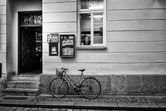 Woman, Bicycle and Pub (Petr Kleiner) Tags: woman bicycle pub street blackandwhite fujifilmx100 windows