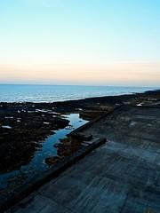 Breaking Dawn (bimbler2009) Tags: ocean sea sky beach water sunrise landscape coast seaside sand outdoor wave shore colourful rockpools fujifilms9900w
