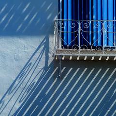 house of blue light (msdonnalee) Tags: blue shadow window azul wall curtain sombra ombre bleu explore sombre blau shadowsonthewall wroughtironshadows schafften